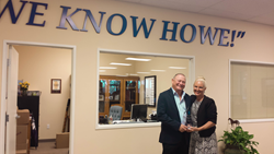 bill and tina howe with 2014 finalist torch award for marketplace ethics
