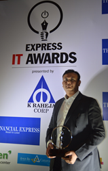 Mr. Sushil Tyagi, Director, CRMnext, with the Express IT Award on stage.