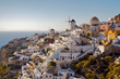 The blue-domed churches and whitewashed houses of Oia village on the Greek island of Santorini
