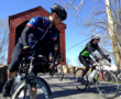 Riders at the 2014 Face of America ride through the Loys Station Bridge.