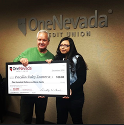 ONCU Kids Holiday Card ARt Contest Grand Prize winner received $100 check from ONCU CFO, Paul Parrish.