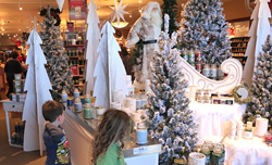 Children watching the Winter Wonderland retail track display by 888 Brands LLC in Yankee Candle Williamsburg VA