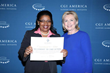WVI President with former Secretary of State Hillary Clinton at the Clinton Global Initiative in Denver, Colorado.