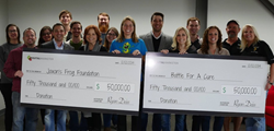 Digital Marketer presents checks to local Austin and San Antonio charities.
