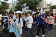 Hundreds of volunteers walked through the streets of Kaohsiung  December 6 to commemorate Human Rights Day.
