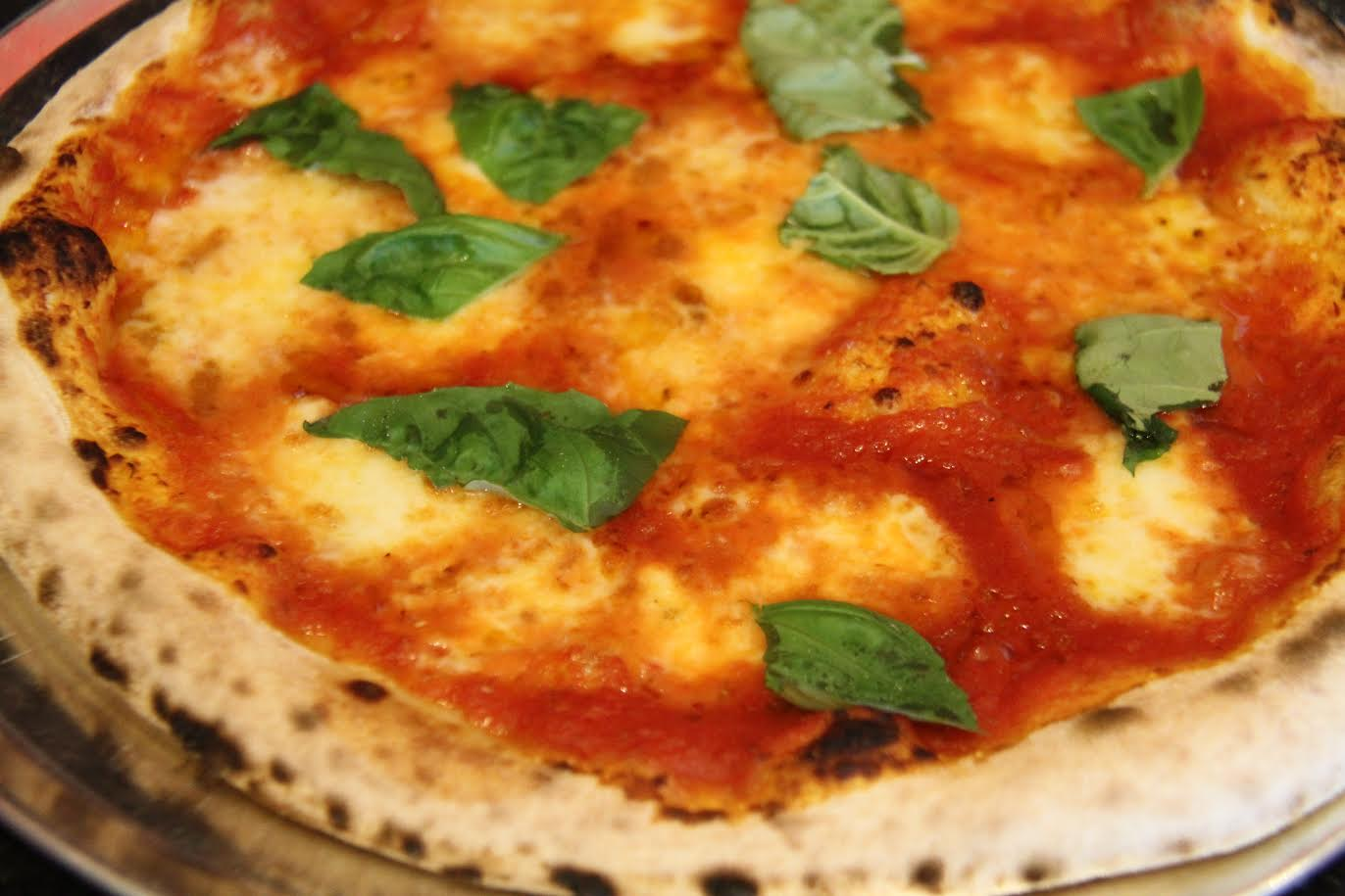 1000 degrees a fast casual neapolitan pizza franchise is coming our famous margherita pizzasimple classic and delicious our margherita pizza is something special