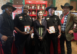 The Captain and Exec Officer of the Phoenix Company of the Arizona Rangers at the Wild Western Festival earlier this year along with Dr. Buck the Festival's Director (l), Emily Jones from Galaxy Press (center) and John Goodwin President Galaxy Press (rt).