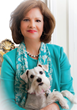 Author Kristin Kaufman with her rescued white Schnauzer and constant companion, LuLu.