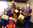 Smile Savers Dentistry staff with Christmas gifts for HopeWorks.