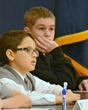Thinking of the world beyond themselves, contestants ponder their answer in the Everest Academy National Geographic Society Geography Bee
