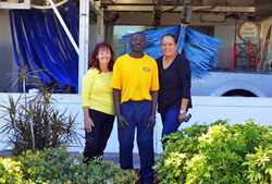 Photo of Job Coach Linda Lennox, Alcinor Aurelien, and VR Senior Counselor Frances Branch stand in front of Mister Car Wash.