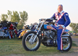 Doug Danger sits atop Evel Knievel's Harley Davidson XR-750 motorcycle at the Sturgis Buffalo Chip.