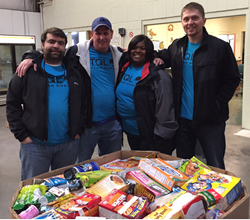 Team members from TQL's Mobile office give back at the Bay Area Food Bank