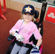 Reagan Imhoff throws out the first pitch at a Houston Astros game, courtesy of CITGO.