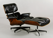 Charles and Ray Eames for Herman Miller chair and ottoman, chair with original label and original black leather, upholstery and rosewood shell