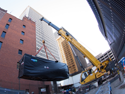 Despite four degree temperatures in Connecticut, workers today installed a Doosan fuel cell that will power downtown Hartford's largest apartment building.