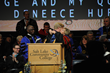 Dr. Deneece G. Huftalin is introduced as Salt Lake Community College's eighth president by her son Max Huftalin, who received a hug afterward.