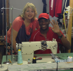 Pierre Garnaud, with his boss, Karina Bramer, at his job as a tailor.
