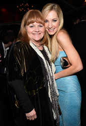 "Joanne Froggatt (R), carries Jill Milan 450 Sutter to a Golden Globes pre-party with ""Downton Abbey"" co-star Lesley Nicol, Jan. 8, 2015 in Los Angeles. (Photo by Michael Buckner/Getty Images for Audi)"