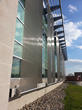 Cambridge Architectural Cubist mesh sunscreens create a dramatic visual effect while providing solar shading for the building's west-facing glass curtain wall.