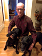Mooney, who will use funding from the Michelson Grant to research a nonsurgical alternative to spaying and neutering dogs and cats, is pictured at home with his two dogs. Credit: Dave Mooney