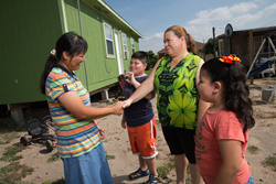 Sr. Emily Jocson greets community members in Penitas on the border near Brownsville, TX