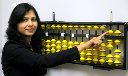 Center Director Shilpi Agrawal and display abacus at the New ALOHA Mind Math learning center in Corona California