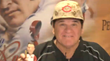 Pete Rose holding one of his bobbleheads