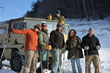 Backcountry snowshoers celebrate the end of an exhilarating hike, and look forward to the off-road trip back to town.