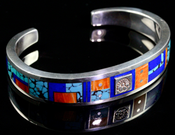 Sterling silver cuff bracelet inlaid with Turquoise, Spiny Oyster, Lapis and Sugilite.