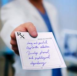 A doctor handing a patient a prescription.