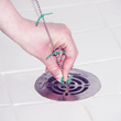 "DrainWig has tiny rubber ""whiskers"" that catch hair spinning in water as it goes down the drain."