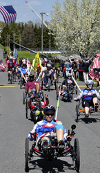 Cyclists complete the 2014 Face of America ride.