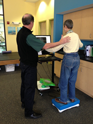 Cape Cod Rehab Physical Therapist Joe Carroll PT DPT SCS uses HUMAC Balance System with client