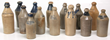 Lot of 14 Stoneware Bottles. Some decorated with cobalt, approximately 10in. to 12 in. high, in good overall condition. Marked Brownell Wheaton & Co. 1856, Walker's Pop, Chas. P. Schaefer Reg'std, Brownell & Wheaton 1867, Bacon, M.H. Swift & Co. White Bee