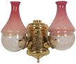 "Double Angle Lamp Wall Sconce. Polished gilt brass fixture signed ""The Angle Lamp Co."" with repousse filigree, rare cranberry opalescent swirl shades and floral etched globes, not electrified. 16 in. high x 18 in. wide x 9 in. deep."
