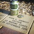 Ryan's tribute can next to his memorial stone in Mt. Olive, NJ.