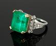 Ladies' 18K gold, platinum and emerald ring, 14.25 ct emerald set with 18 round brilliant cut diamonds