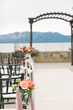 Details like fresh flowers on the aisle personalize The Landing's luxurious lake-view Rooftop Terrace ceremonies (Photo by Lauren Lindley Photography).