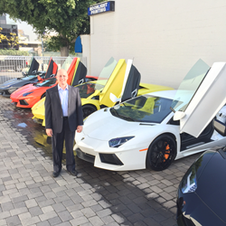 Seth Waskow, GM for Lamborghini and Aston Martin of Beverly Hills, part of O'Gara Coach | Beverly Hills automotive company, shown here surrounded by $3 million worth of Lamborghinis.