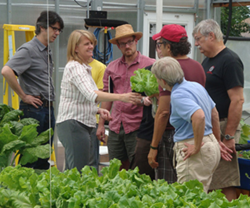 Rebecca Nelson sharing aquaponically-grown lettuce at the Aquaponics Master Class