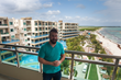 Joey Fatone on the balcony of his infinity pool suite overlooking Generations Riviera Maya, by Karisma
