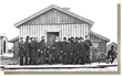 Gen. Ulysses S. Grant (seated center) with his staff  outside h is cabin at City Point in 1864/65