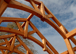 Antique timbers, such as the industrial salvaged Douglas fir timbers crafted into these trusses, provide extraordinary stability, character, and history unmatched by fresh sawn timbers.