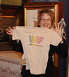 Ginny Durrin holds up the first WIFV t-shirt, circa 1979.  This grassroots organization began when a group of local media makers gathered together, and decided to produce change.