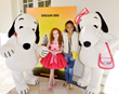 Francesca and Skai Jackson posed with Snoopy and Belle in front of poster for the new Peanuts Movie