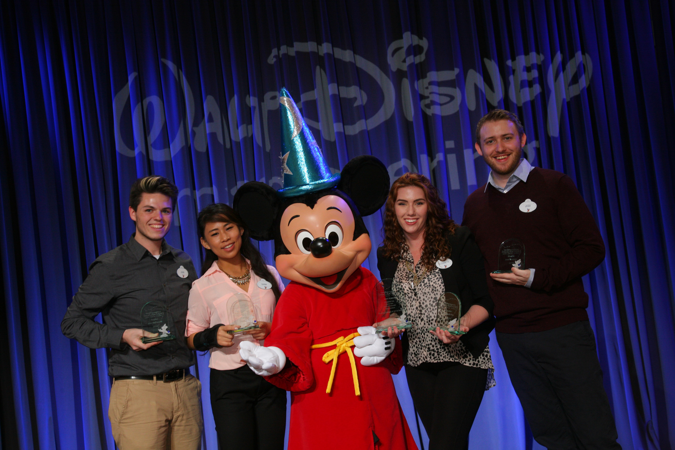 Imaginations First Place Winning Team From Ringling College Of Art And Design With Mickey Mouse John McDonaldDiana Han Elizabeth Fox