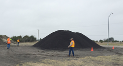 Photo of TxDOT maintenance teams training on how to measure a stockpile using an iPhone.