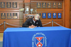Micah Keels signs his commitment to play for the prestigious University of Richmond.