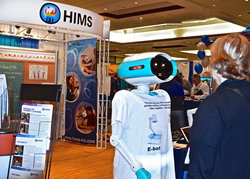 Big-E the promotional robot speaking to an ATIA attendee